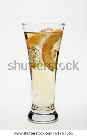 Peach Cocktail against a white background. - stock photo