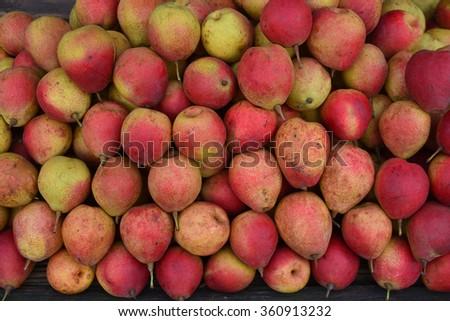 Peach in fruit market, lemon background - stock photo