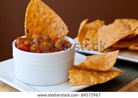 Peach Mango Salsa with chipotle Chips - stock photo
