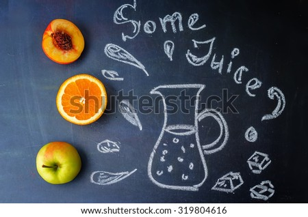 Peach, orange, Apple fruits with words some juice is written with chalk on a blackboard. toning. selective focus - stock photo