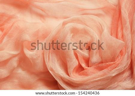 Peach silk background with round drapery  - stock photo
