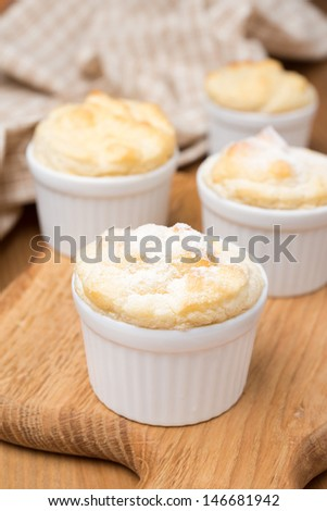 peach souffle in portioned forms on a wooden board - stock photo