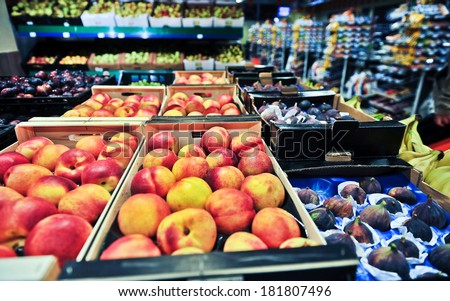 peaches and figs at the grocery store - stock photo