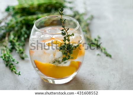 Peaches and thyme cocktail or lemonade or infused water - stock photo