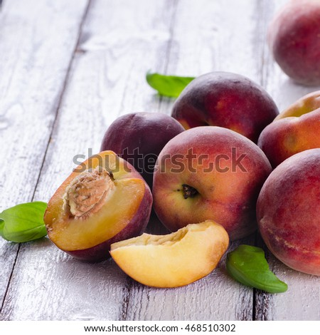 Peaches on white wooden background