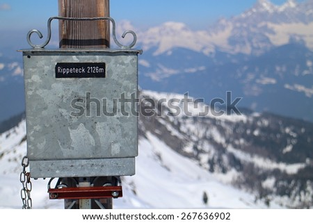 Peak box (summit case) with summit book on the top of Rippetegg, Austria - stock photo