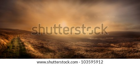 Peak District moorland panorama. Axe Edge in the Peak District National Park. Late afternoon sun being obscured by an approaching weather front. - stock photo