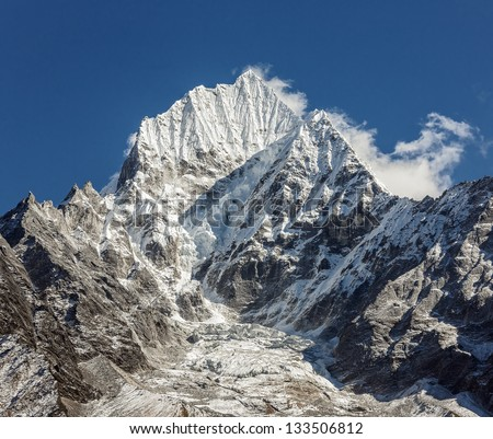 Peaks Kantega (6783 m) and Thamserku (6608 m) from Teshinga village - Nepal, Himalayas - stock photo