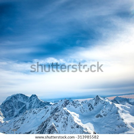 Peaks of blue mountains in snow. Winter natural landscape - stock photo
