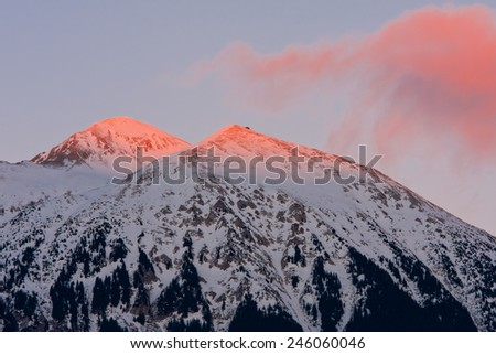 Peaks of Stol (2236m) in sunset - stock photo