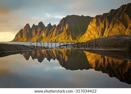 Peaks of the Okshornan mountain in sunset lights. Senja island, Norway - stock photo