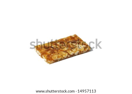 Peanut brittle crunchy sweet nut snack - stock photo