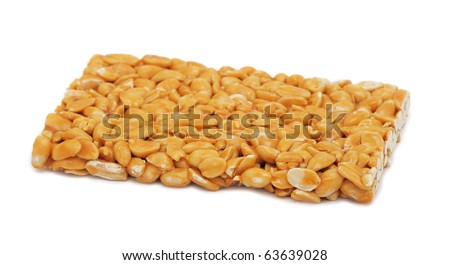 Peanut brittle, isolated on a white background - stock photo