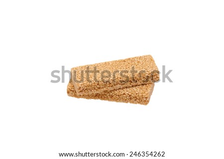 Peanut brittle with sesame seeds. Isolated on white.                                - stock photo
