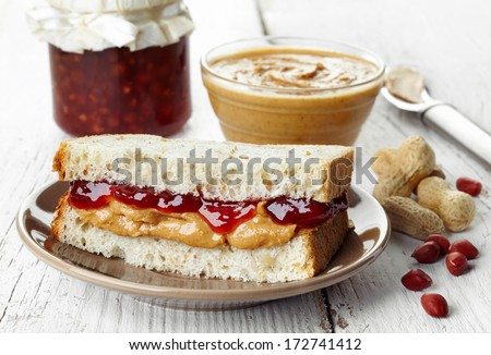 Peanut butter and strawberry jelly sandwich - stock photo