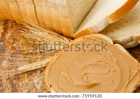 Peanut butter is a delicious snack and food allergen - stock photo