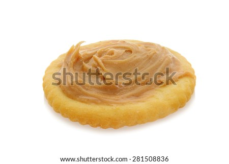 peanut butter on round cracker - stock photo