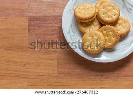 Peanut cream cracker biscuits on a plate - stock photo