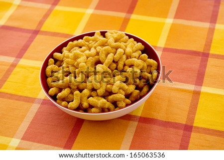 Peanut flips served in a white bowl, isolated on yellow background   - stock photo