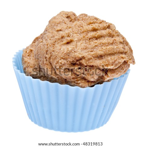 Peanutbutter Cookies in a Vibrant Cupcake Wrapper.  Isolated on White with a Clipping Path. - stock photo