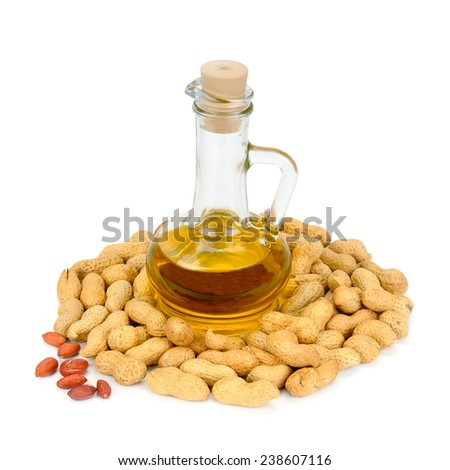 peanuts and oil in bottle isolated on white background - stock photo