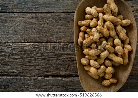 peanuts on wooden surface
