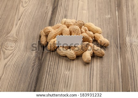 Peanuts on wooden table. Close-up studio photography. Copy space for text.