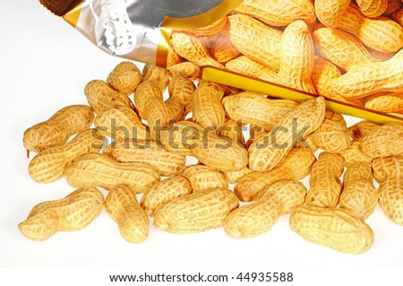 Peanuts Scattered On A Table - stock photo