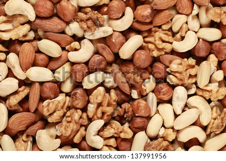 Peanuts, walnuts, almonds, hazelnuts and cashews forming a nuts background