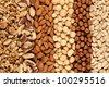 Peanuts, walnuts, almonds, hazelnuts, Brazil nuts and Macadamias side by side - stock photo