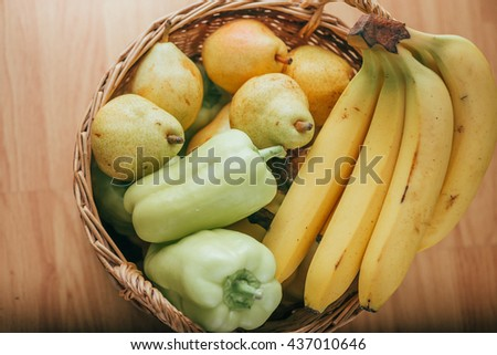 pear, banana and green pepper in a basket