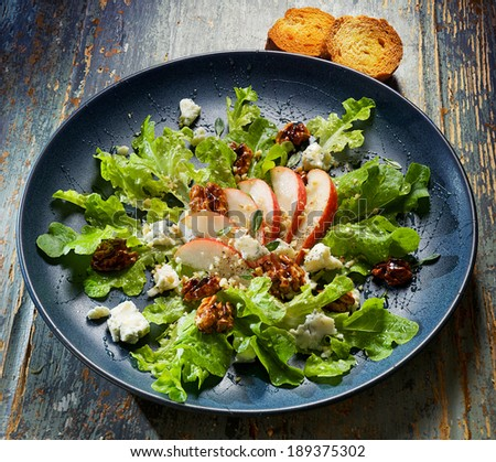 Pear, blue cheese and caramelized walnuts salad - stock photo