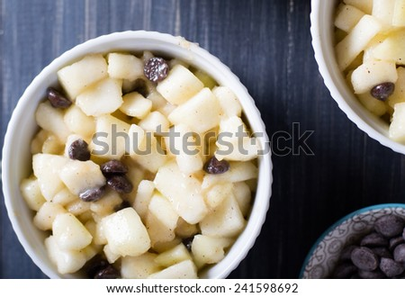 Pear chocolate crumble in the making - stock photo