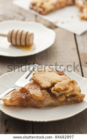 Pear - honey galette over wood table - stock photo