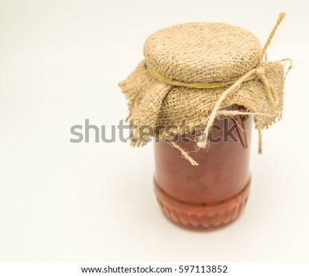 pear jam jar covered with sackcloth caught with rope