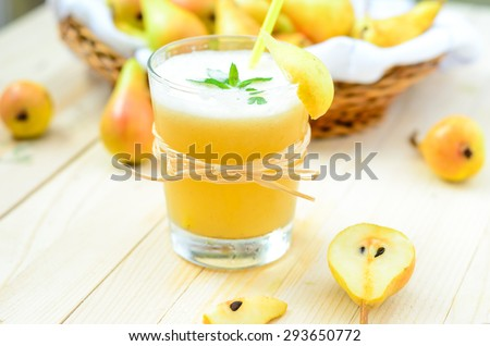 Pear Juice with fresh fruits on wooden boards - stock photo