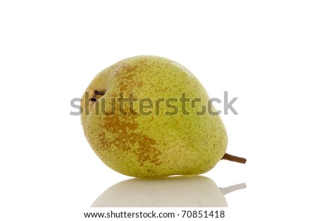 Pear lying on a reflective shiny white background.