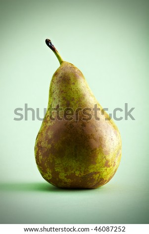 pear on a green background with vintage effect - stock photo