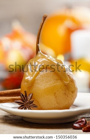 Pear with caramel sauce. French dessert - stock photo