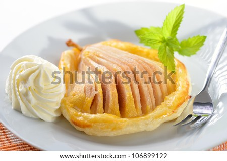 Pear with honey on puff pastry - stock photo