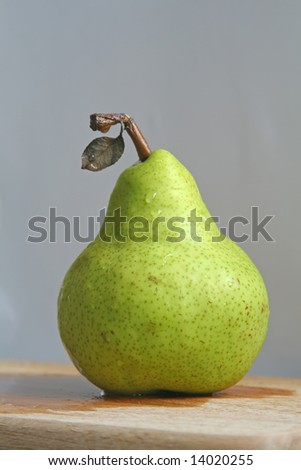 pear with leaf still intact - stock photo