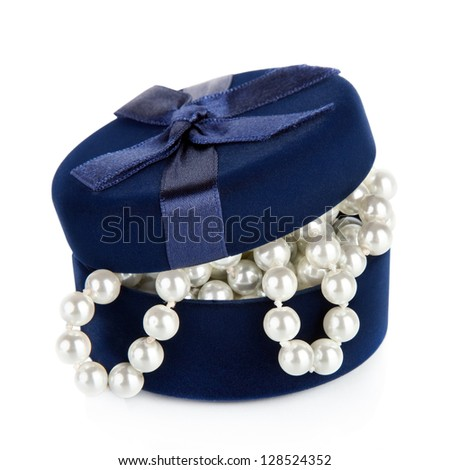 Pearl beads in the slightly opened casket isolated on white  background - stock photo
