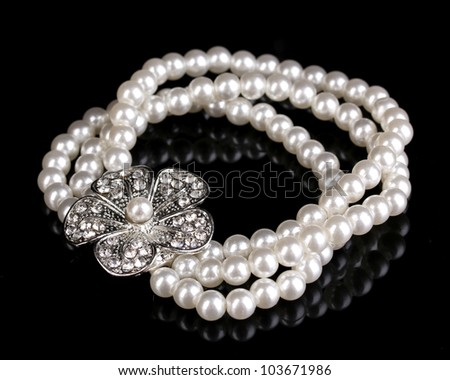 Pearl bracelet isolated on black - stock photo