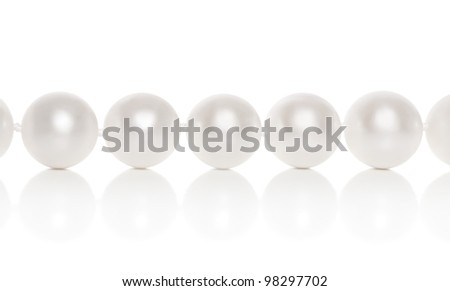 Pearl close-up on a white background with reflection - stock photo