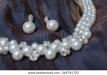 Pearl earrings on background
