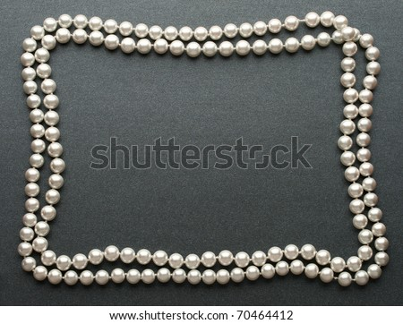 Pearl isolated on grey - stock photo