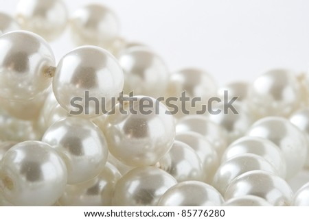 Pearl isolated on white - stock photo