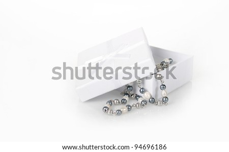 pearl necklace in white box - stock photo