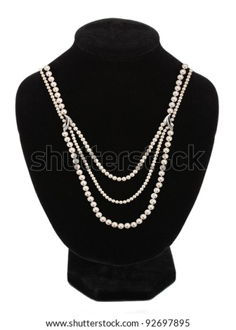 Pearl necklace on black mannequin isolated - stock photo