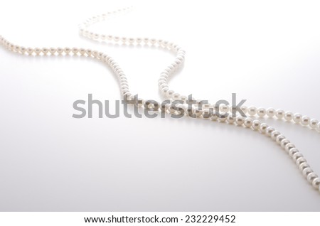 pearl necklace on whitebackground - stock photo